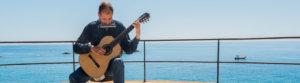 Martí Batalla playing the guitar at Tossa de Mar, Catalonia, Spain